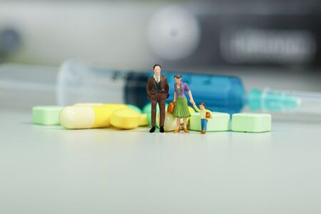 Miniature people - The family with Medicine pills