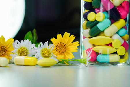 Medicine pills with yellow and white flower stock photo picture medicine pills with yellow and white flower stock photo 83667057 mightylinksfo