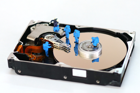 hard disk: Miniature workers repair harddisk drive