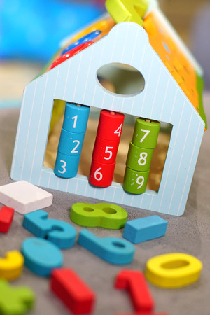 Colorful wooden toys in playroom