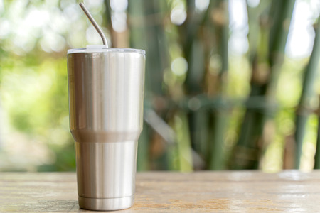 Stainless steel tumbler with stainless straw keeping of the drink cold or hot. Reduce plastic pollution concept.
