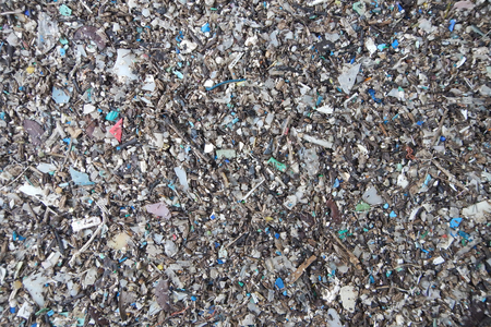 Micro plastics marine debris on the sand beach.