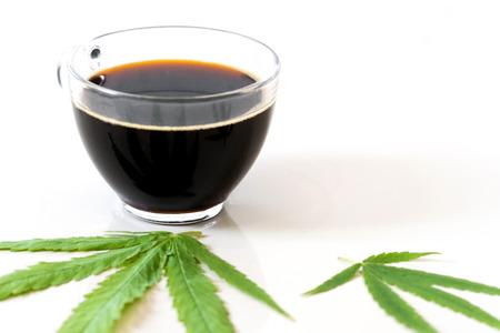 Black coffee with Cannabis(marijuana) leaves. Medical cannabis, Alternative medicine.