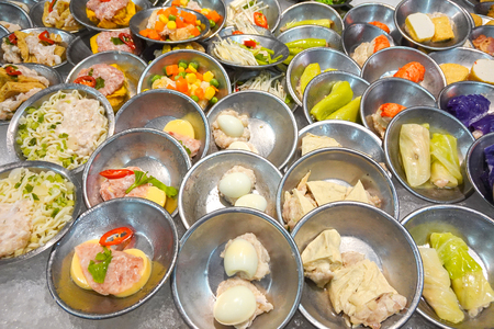 Chinese dimsum bamboo steamer. Dimsum in the steam basket. Chinese cuisine. Banco de Imagens