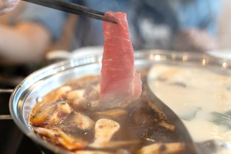 Delicious spicy beef shabu shabu in the hot pot. Banco de Imagens