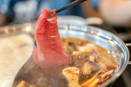 Delicious spicy beef shabu shabu in the hot pot. 스톡 콘텐츠