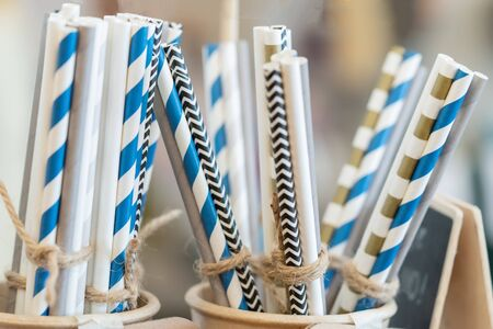 Drinking paper colorful straws for reusable and reduce the use of plastic straw. Reduce plastic waste in environment.