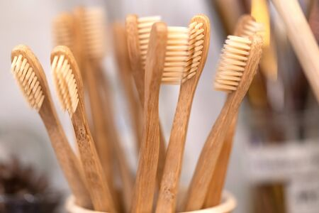 Bamboo toothbrush in zero waste shop. Eco friendly biodegradable toothbrush.