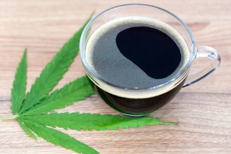Black coffee with Cannabis(marijuana) leaves. Medical cannabis, Alternative medicine.
