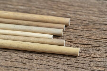 Bamboo wood straws for reusable and reduce the use of plastic straw. Reduce plastic waste in environment. Stok Fotoğraf