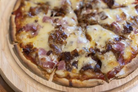 Hot homemade barbecue chicken pizza with onions and cheese and mushrooms.