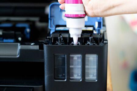 Refill ink cartridges, printer Inkjet colors. Repairs and Maintenance inkjet printers concept Stockfoto