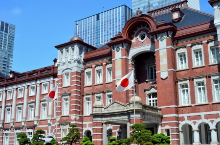 Tokyo station and flags of Japan