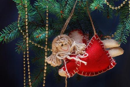 Christmas angel decoration on a pine tree photo