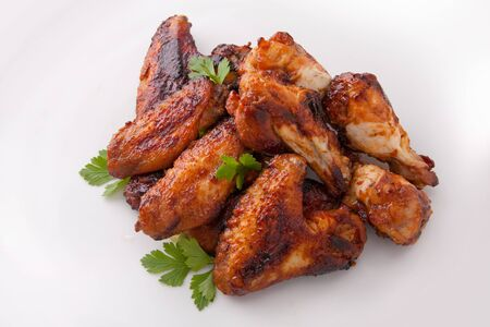 A white plate of delicious barbecue chicken wings