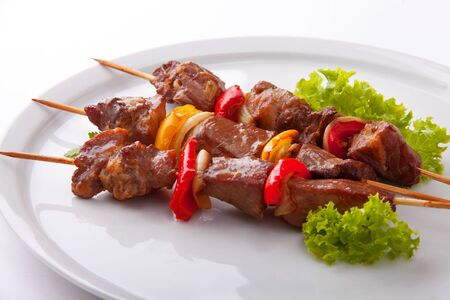 Barbecue dish. Kebabs - grilled meat and vegetables