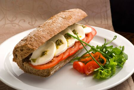Traditional Italian sandwich with ham and cheese on a white plate Stock Photo