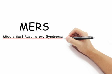 coronavirus: hand with pen writing MERS Middle East Respiratory Syndrome coronavirus on pure white background