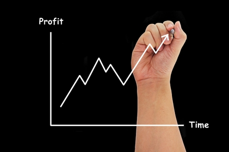 hand drawing a graph of Profit and time on dark black background