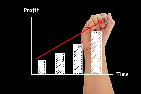 human hand writing growth bar chart photo