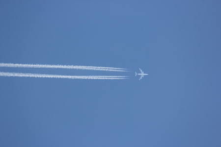 Airplane contrail against clear blue sky
