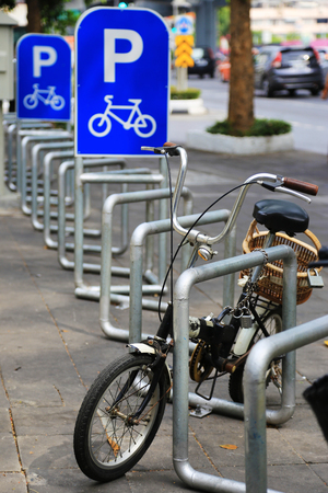 a two wheeled vehicle: Bike Parking Lot with the bicycle Stock Photo