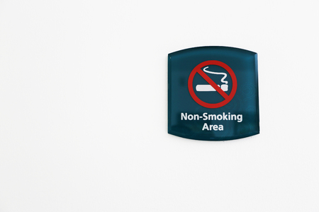 green Non Smoking Sign on white Wall
