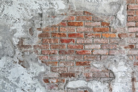 vintage rustic old red brick wall. some part cover with white clay with copy space