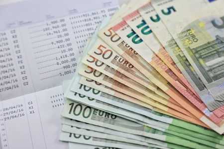 Many euro banknotes and bank account passbook show a lot of transactions. concept and idea of saving money investment interest bank loan inflation expenses Banco de Imagens
