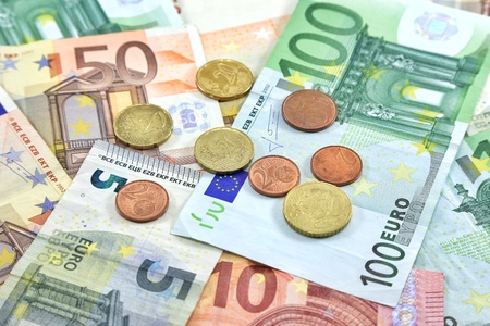 Euro coins place on  Money Banknotes as background.