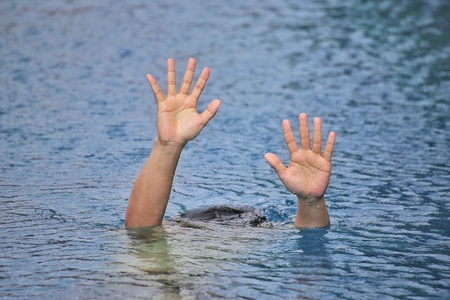 Man drowning in out door swimming pool while swimming alone, show two hands and asking for help