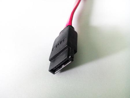 sata: sata cable plug on white background