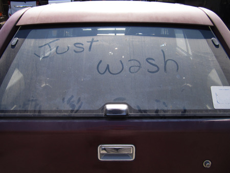 just wash, words on a dirty car window