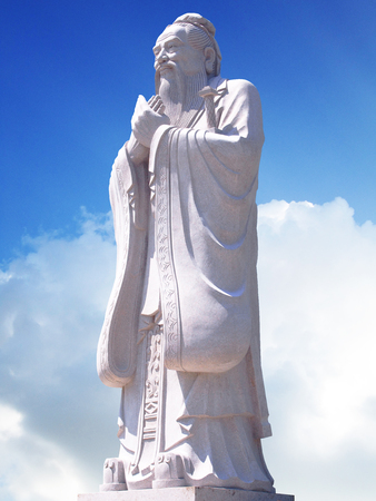 Confucius statue with sky background Stock Photo