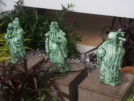 deities: Chinese god of fortune, prosperity and longevity figurine called three goddesses Fu Lu Shou in the small garden