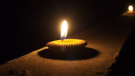 burning flat candle at night isolated on dark background Stock Photo