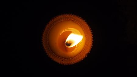 burning flat candle at night isolated on dark background Stock Photo