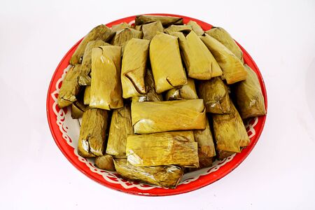 boiled mush stuffed in banana leaves with white background Stock Photo