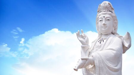 guan yin the goddess of mercy statue with sky background
