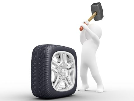 heavy heart: Person make square car wheel by hammer Stock Photo