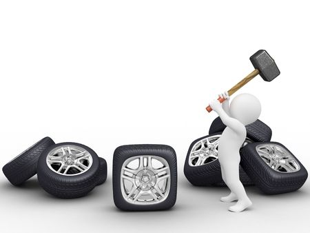 car wheel: Person make square car wheel by hammer Stock Photo