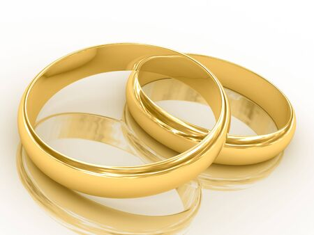 Two golden wedding rings with reflection. Isolated on white. photo