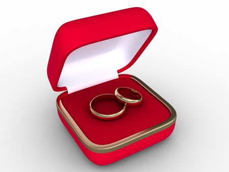 Two golden wedding rings in open red box. Isolated on white.