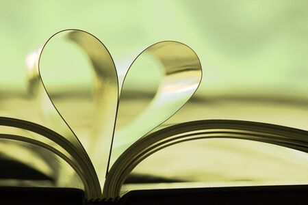 turning the page: Photo Of Book With Hart Shaped Pages, Back Lit.