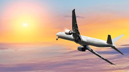 Commercial airplane flying above beautiful sky in dramatic sunlight.Travel and transportation concept. Archivio Fotografico