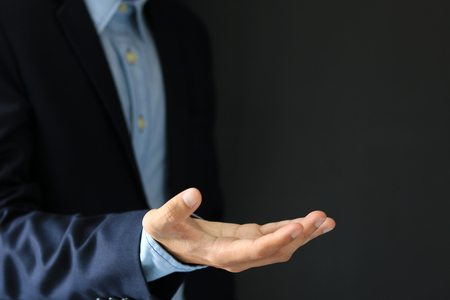 business man making a gesture hand For use in a variety of applications.