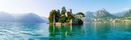 View of Loreto Island in Italy and the hills in the background on a sunny day