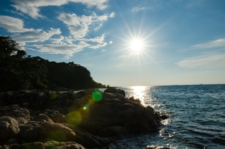 rock strata: sunset backlight on the coast with lens flare Stock Photo