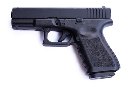 gun fire: Gun isolated on white background Stock Photo