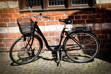 Scene Of A Bicycle In The Rain On A Cobbled European Backstreet Stock Photo